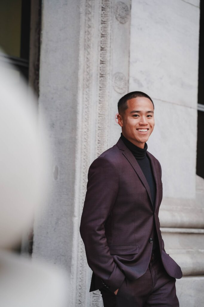 International student smiling in a business suit.