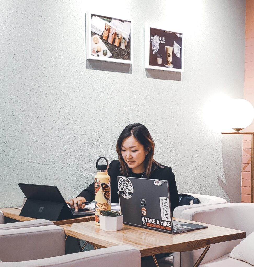 Intern working at a desk on her computer.